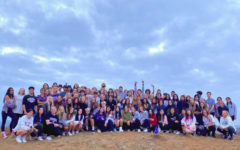 The senior class poses for a photo at the top of Calavera Mountain at the annual Senior sunrise.